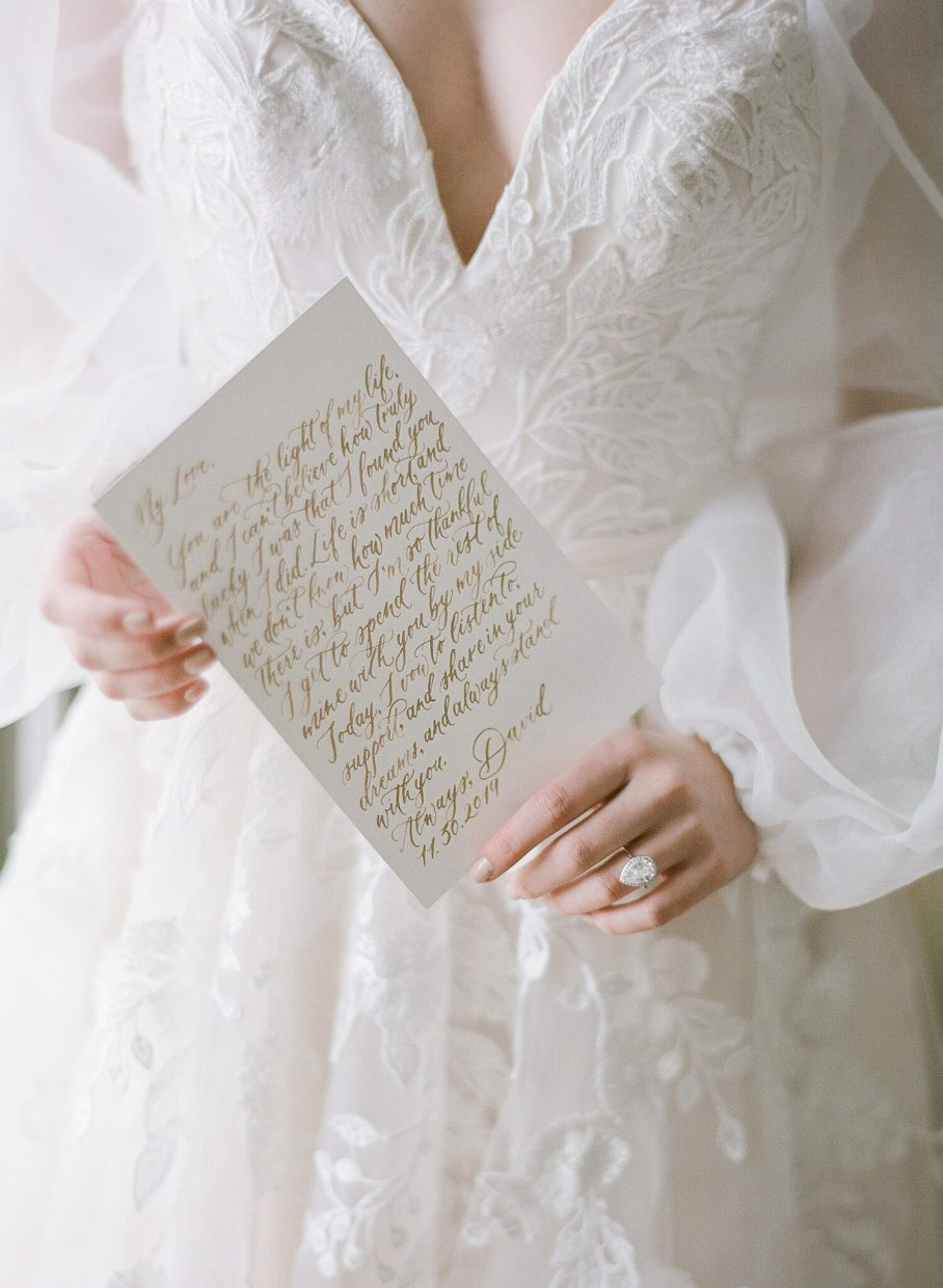 bride holding calligraphed vows