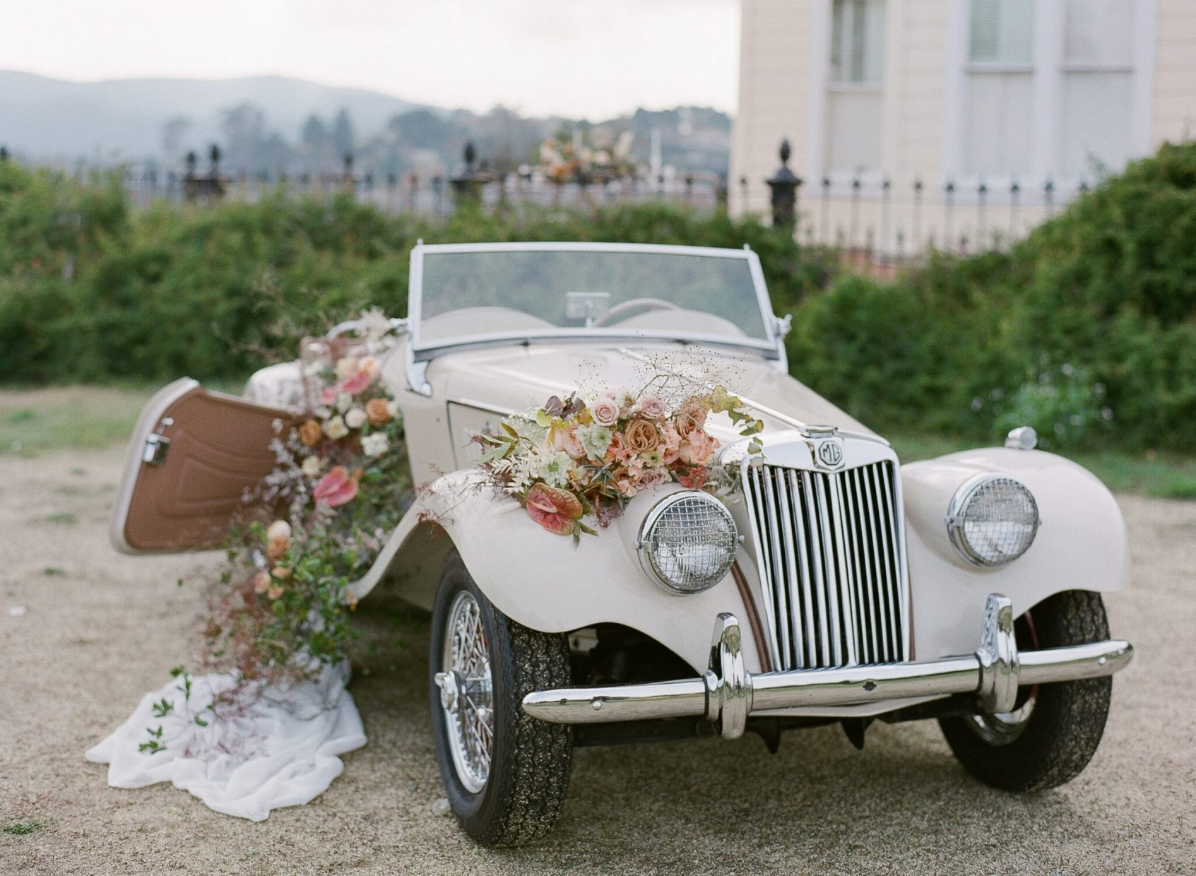 Vintage car dressed in florals at the Lyford House Love story shoot