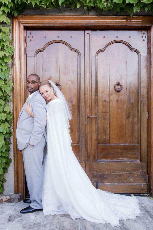 bride hugging her man in a doorway
