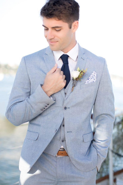 dapper groom in blue