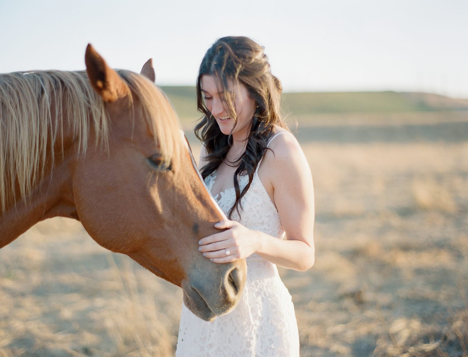 Niki with her horses for an engagement session at Wente