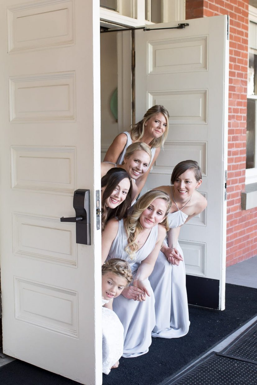 Bridal party sneaking a peak at the couple