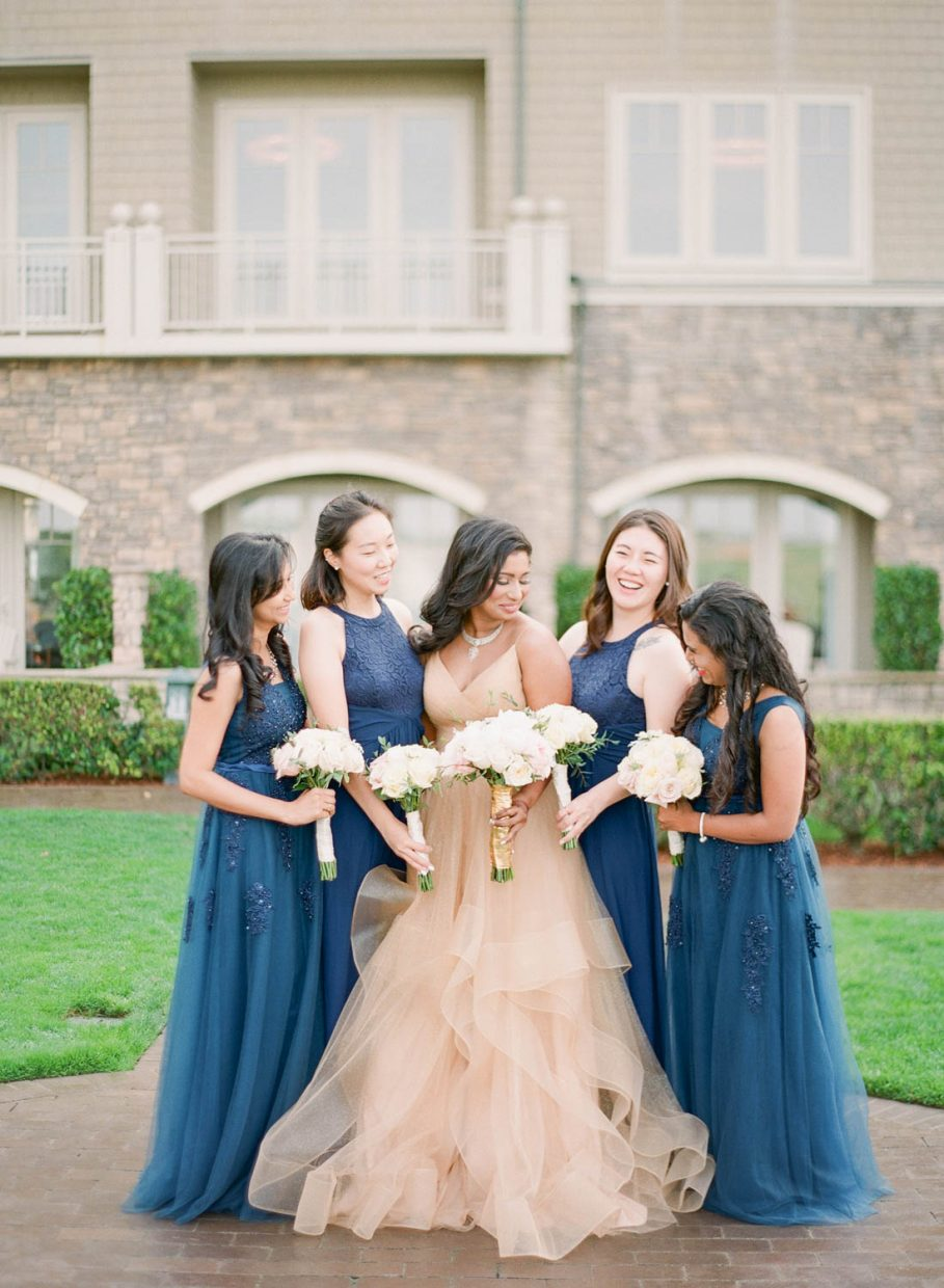 Film image of bride and bridesmaids in front of hotel