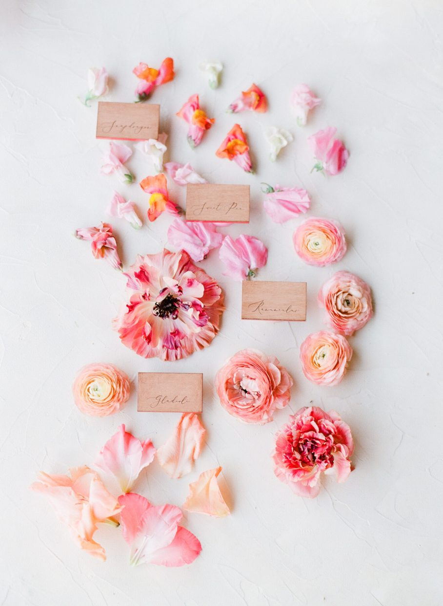 red and pink flat lay of place cards
