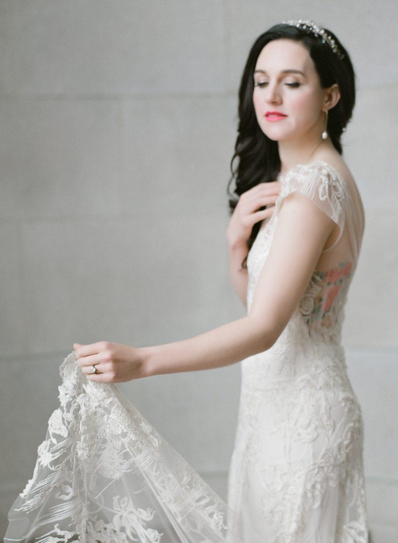 Elegant bride holding her train