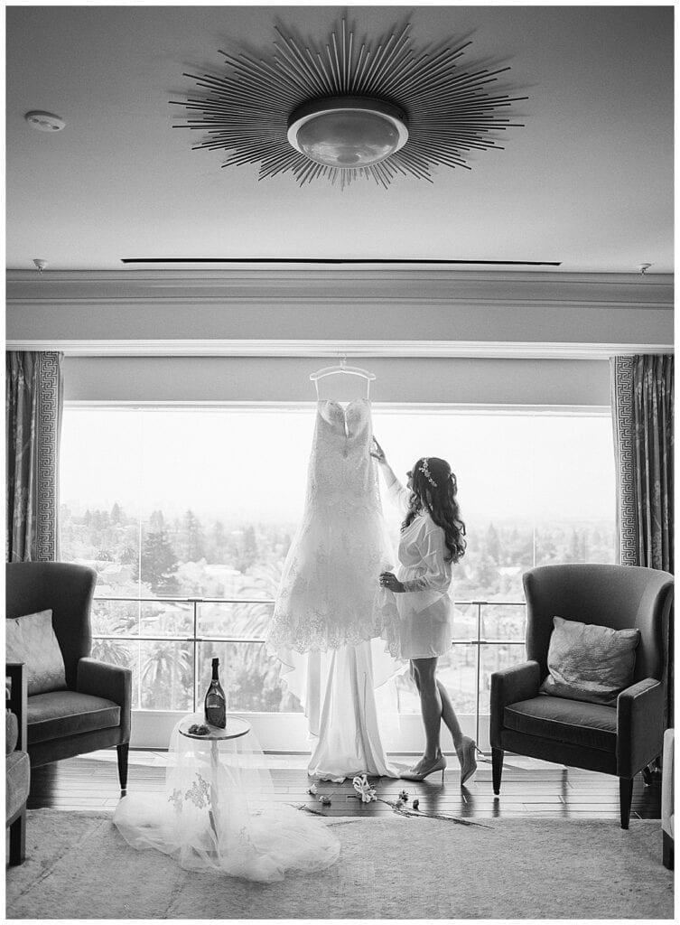 bride reaching for her dress