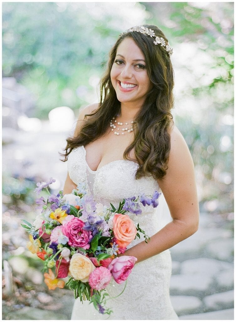 Woman holding flowers smiling
