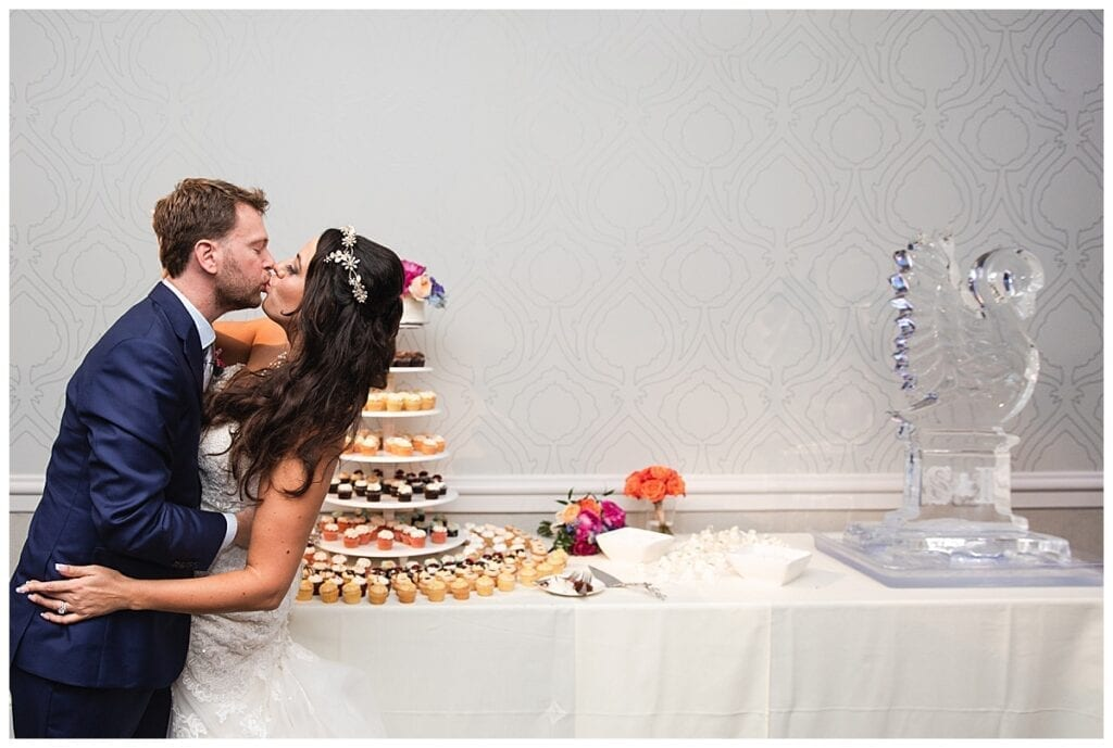 Kiss in front of the Ice Sculpture and cupcakes