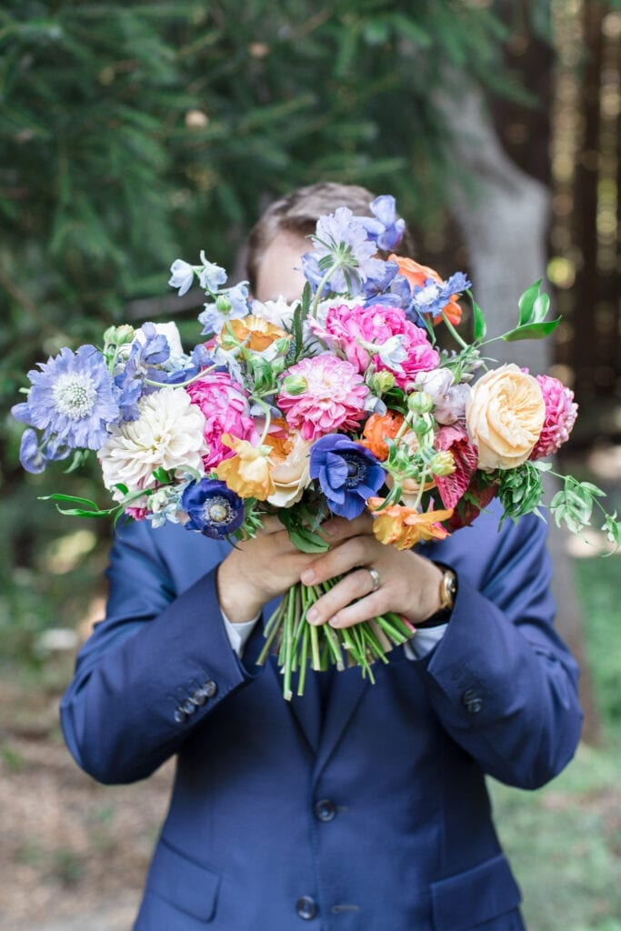 Flowers in front of a mans face