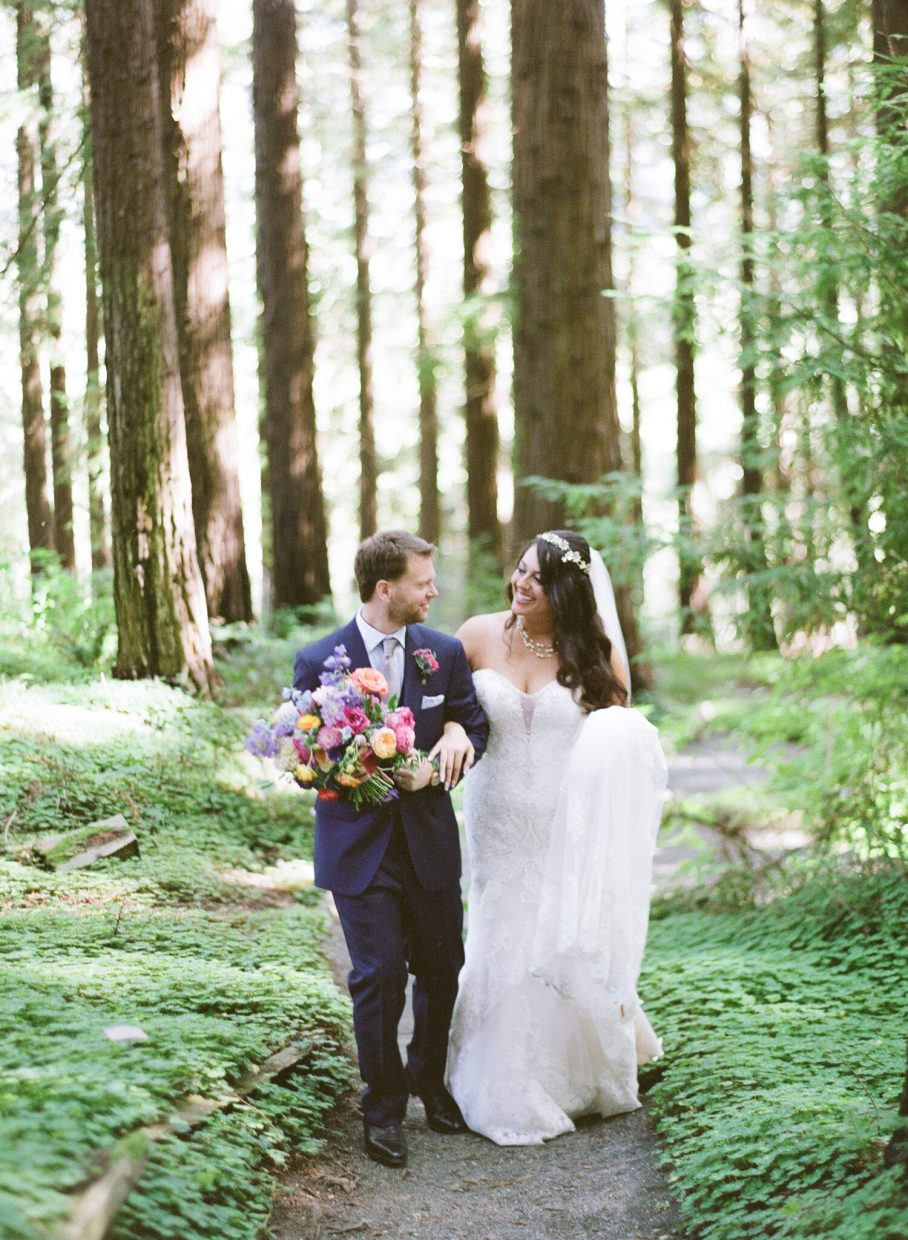 Wedding couple walking through trees