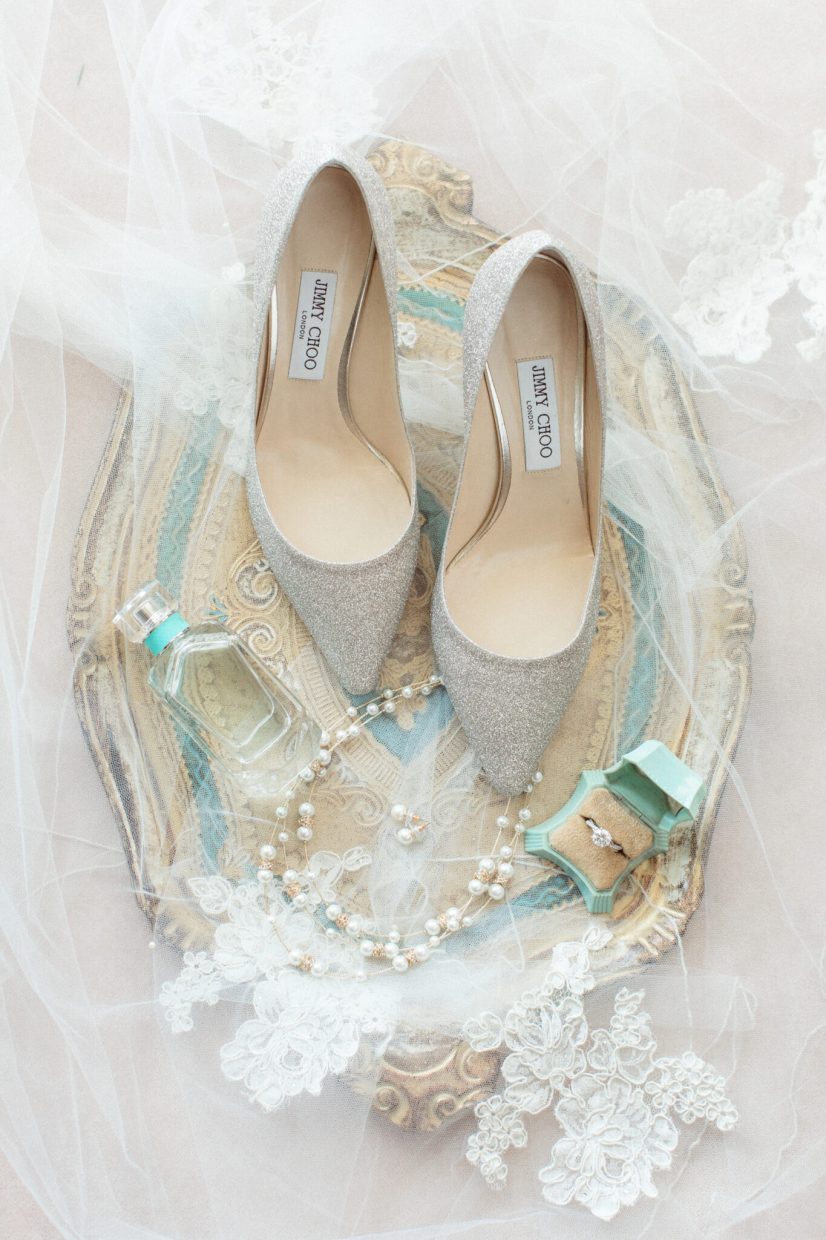 Fine art flat lay of wedding Jimmy Choo shoes