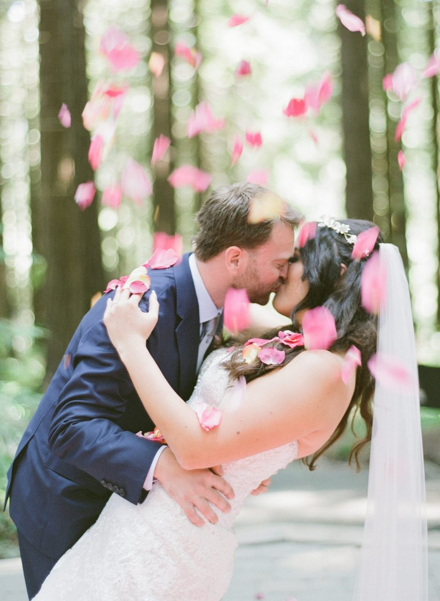 The kiss with petal toss