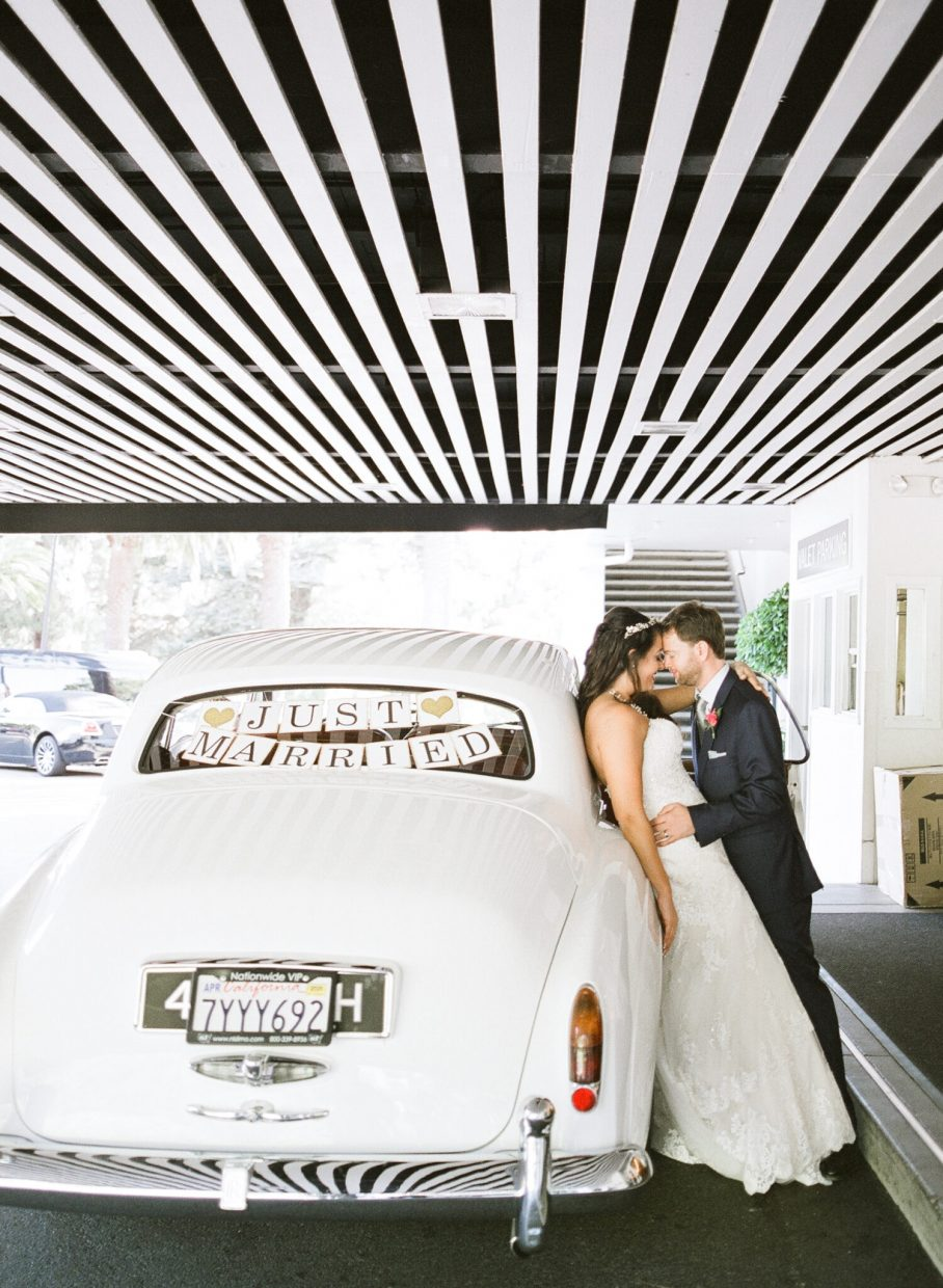 Bride and groom with vintage Rolls-Royce at Claremont Club and Spa