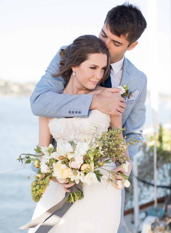 Sailboat elopement couple