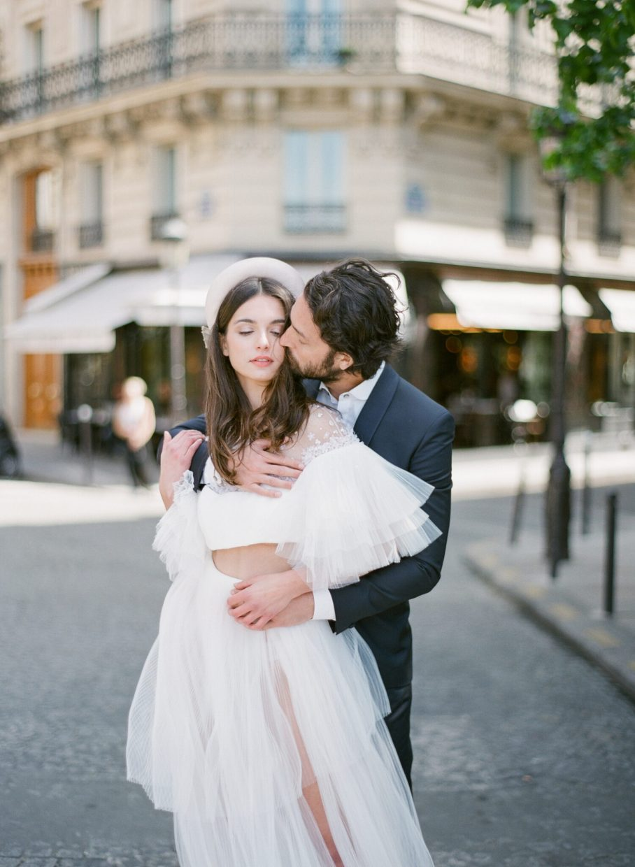 Groom holding his bride in the streets of France