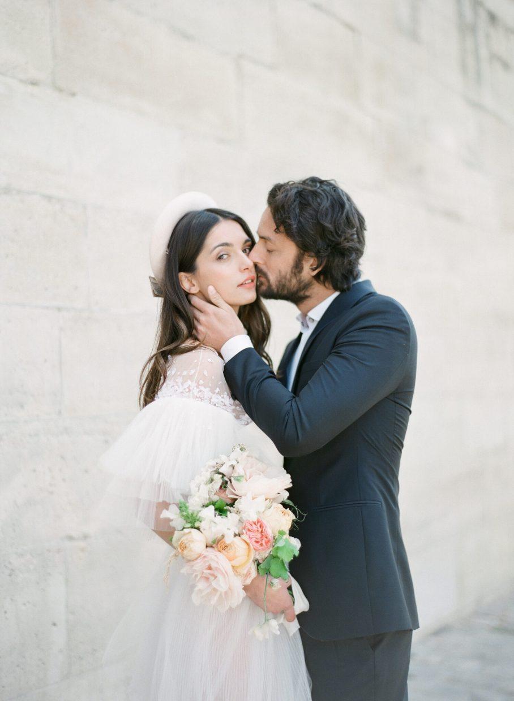Parisian couple kissing passionately