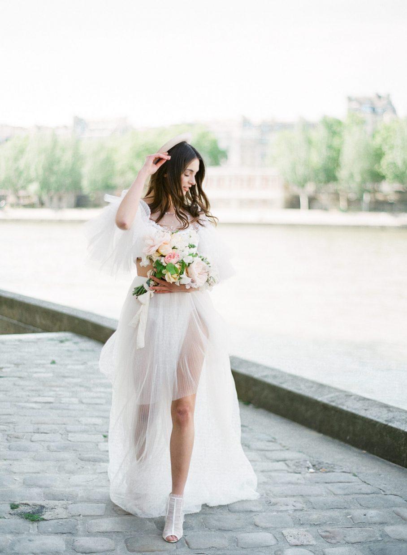 Parisian bride running along the seine river