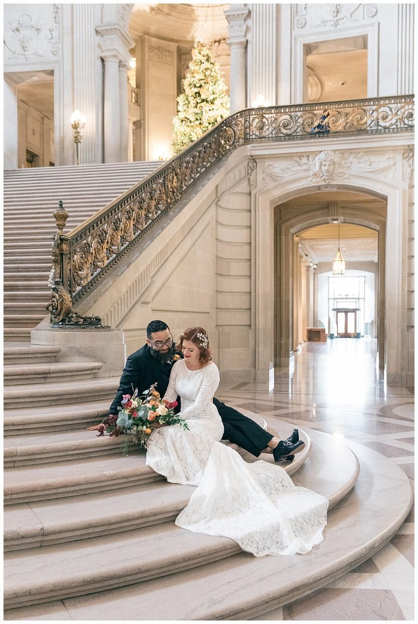 couple sitting on a staircase after being married