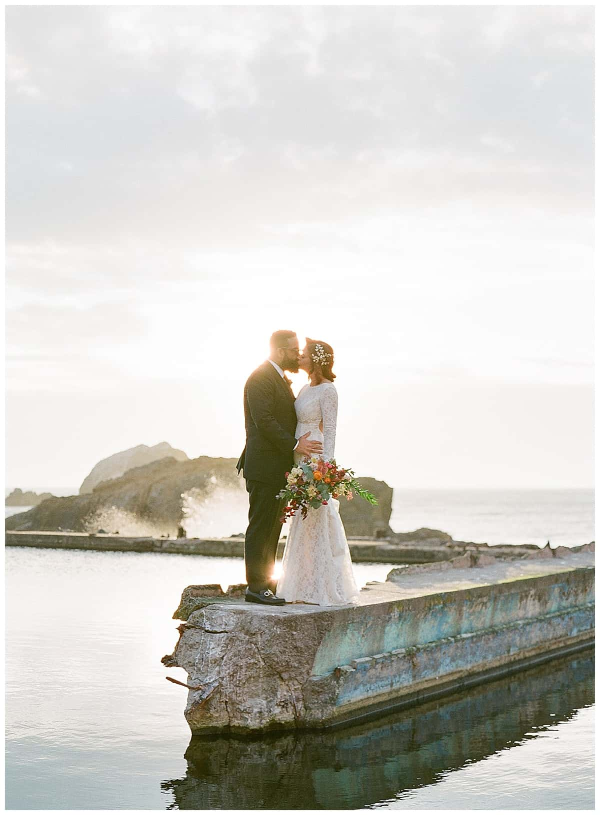 Sunset behind couple at Sutro Baths