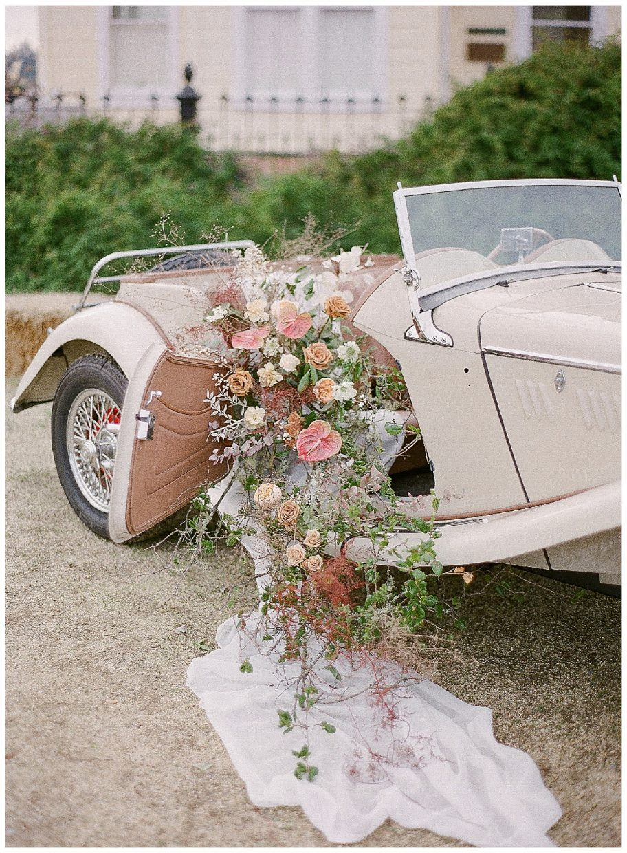 Florals spilling out of vintage car