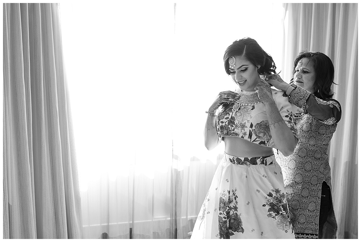 Indian Bride getting ready with her mom