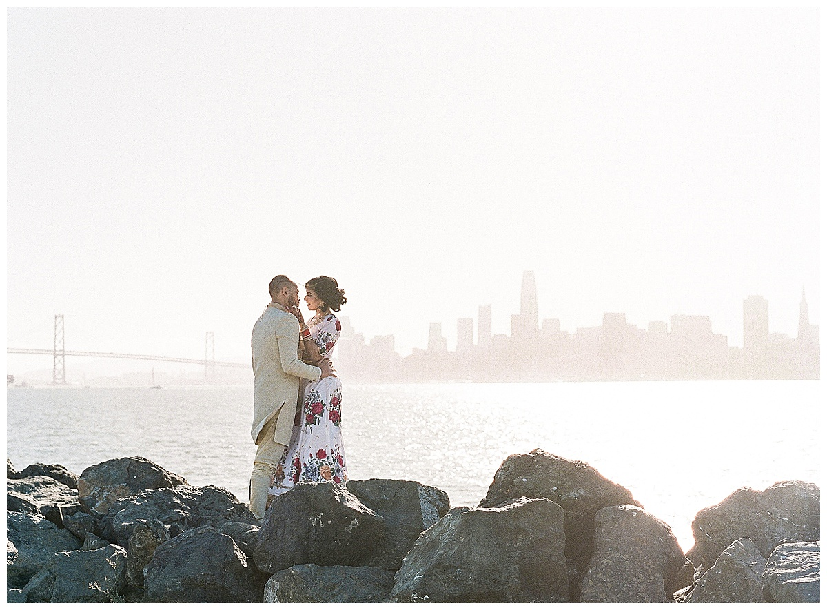 Couple standing in front of San Francisco city scape view