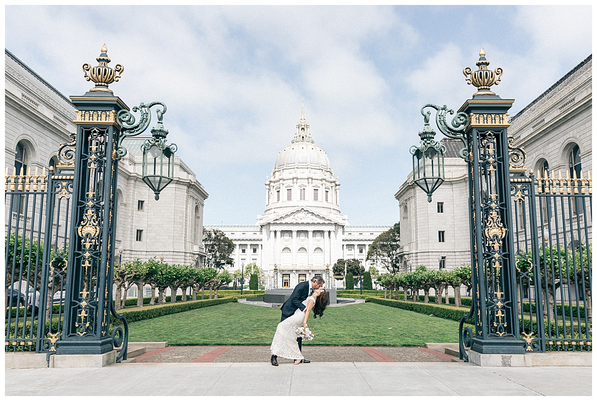 iconic photo of the city hall with a guy dipping his woman