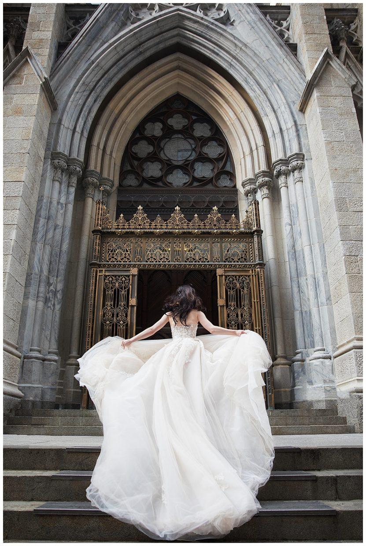 Lena Hall is a Galia Lahav Bride running up St. Patrick's Cathedral in NY