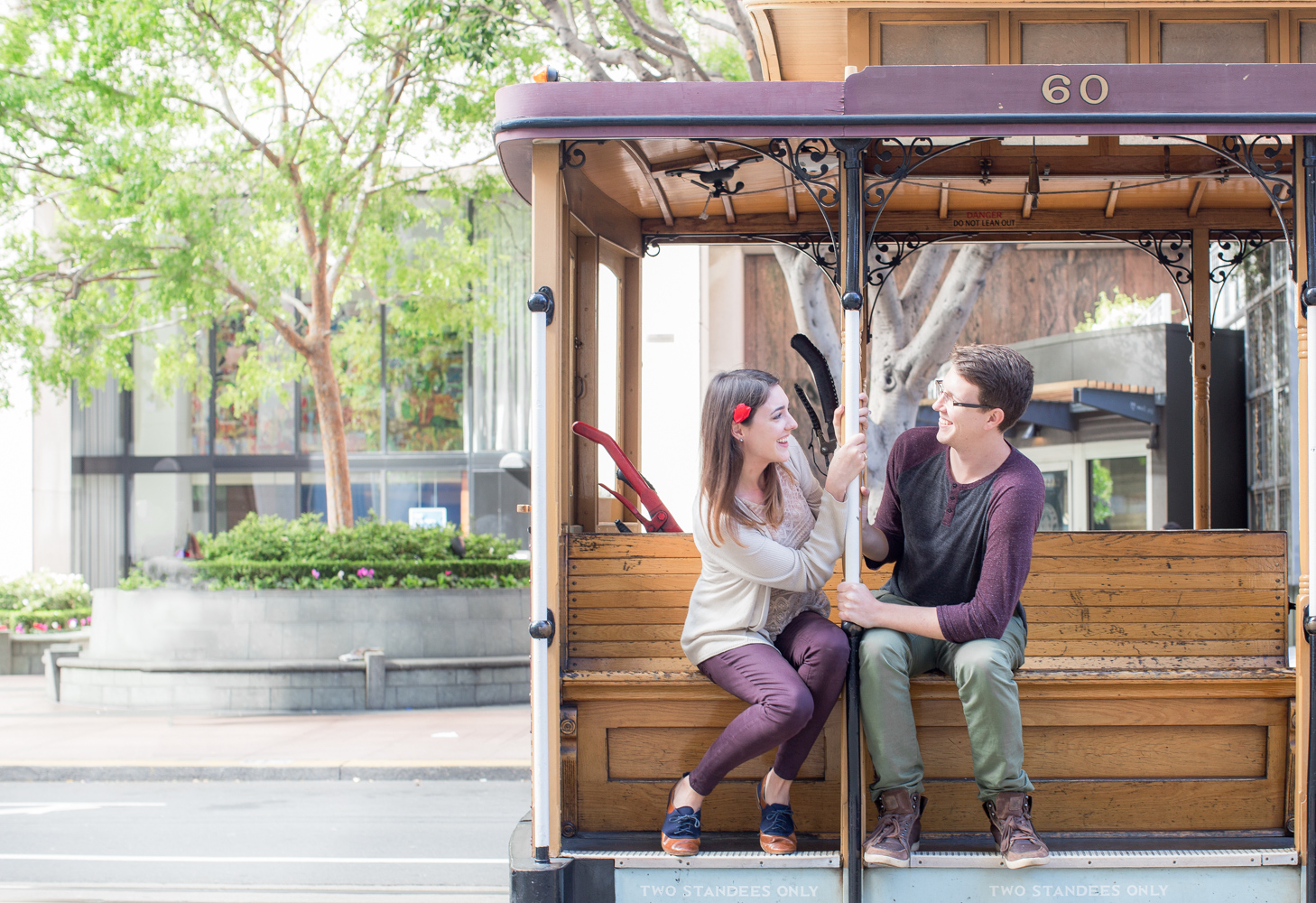 cable car in San Francisco with couple being cute