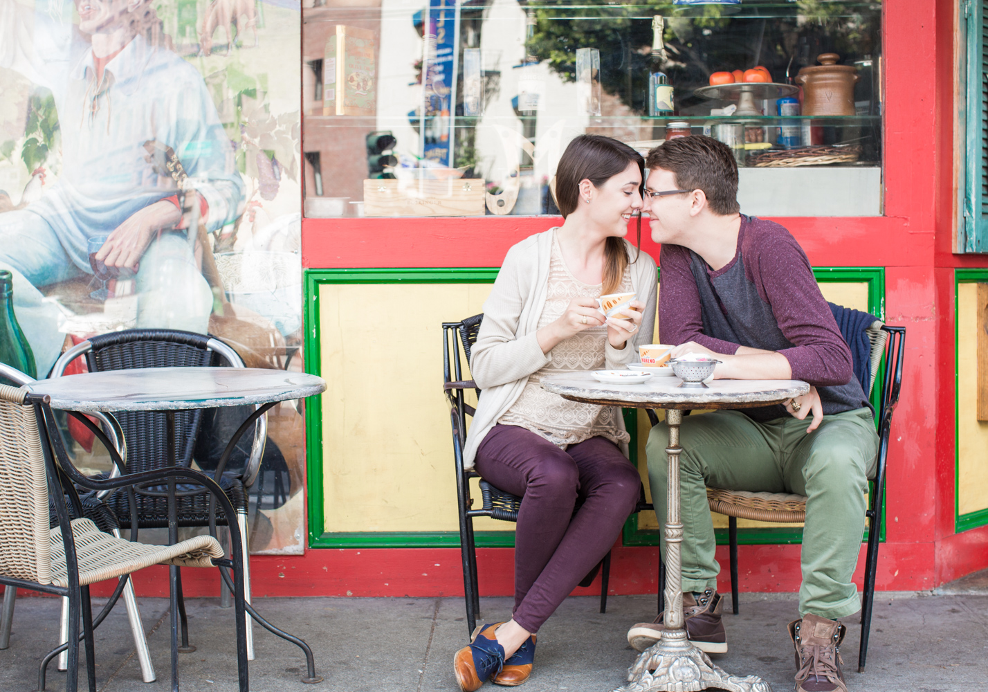 couple having coffee in north beach kissing