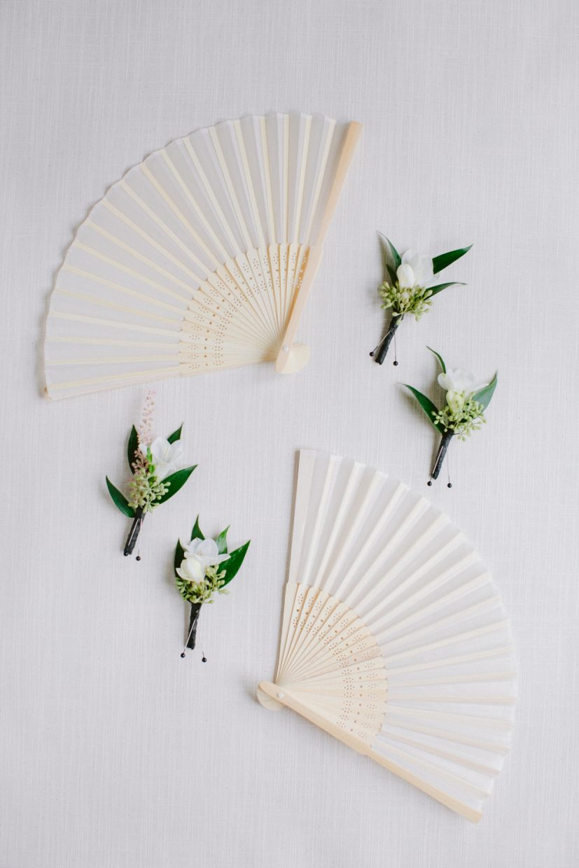 Fans and boutonnieres flat lay