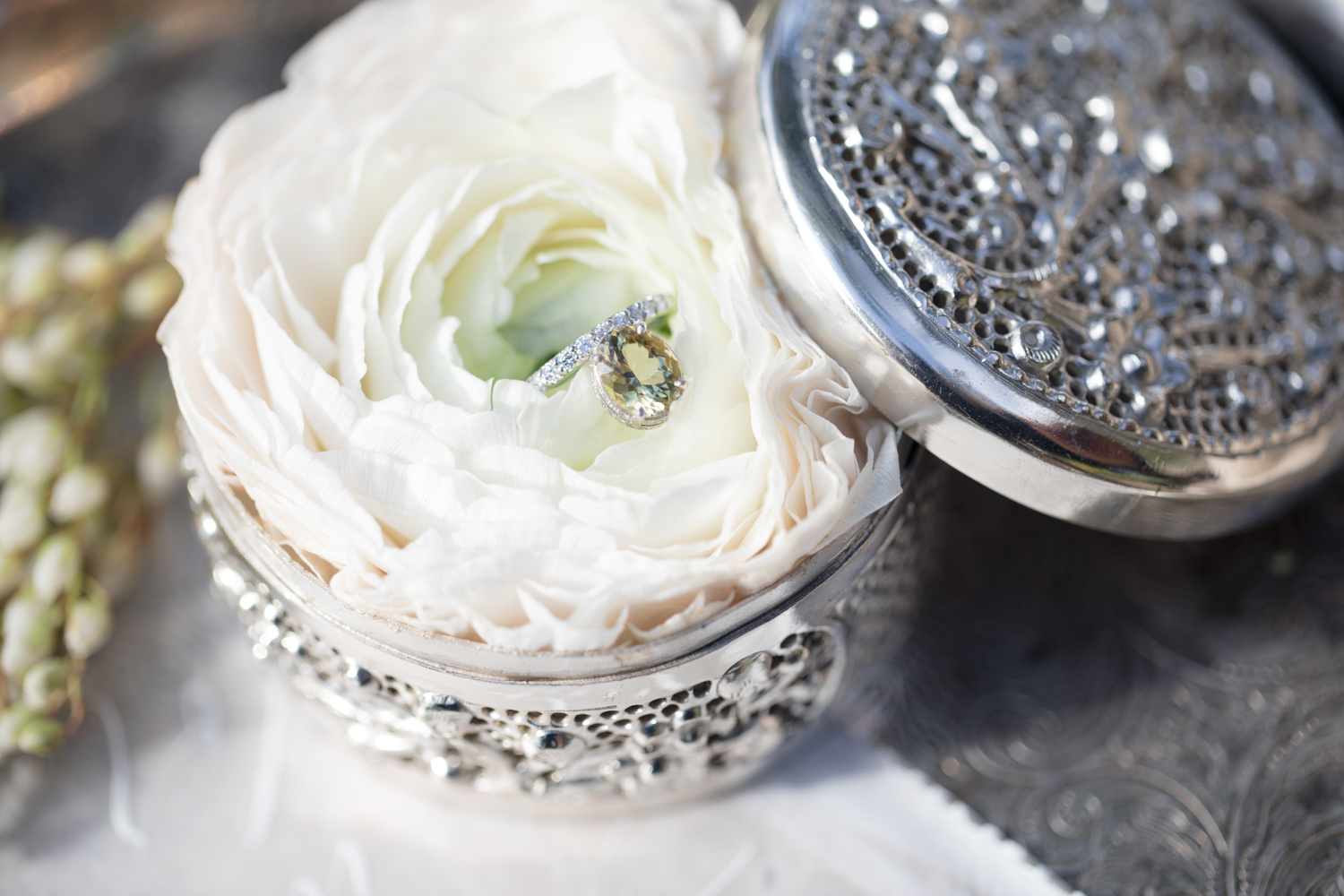 Engagement ring in the center of a peony