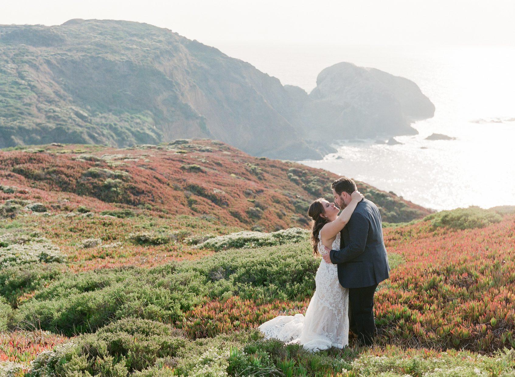 Girl and Boy hugging cliffside