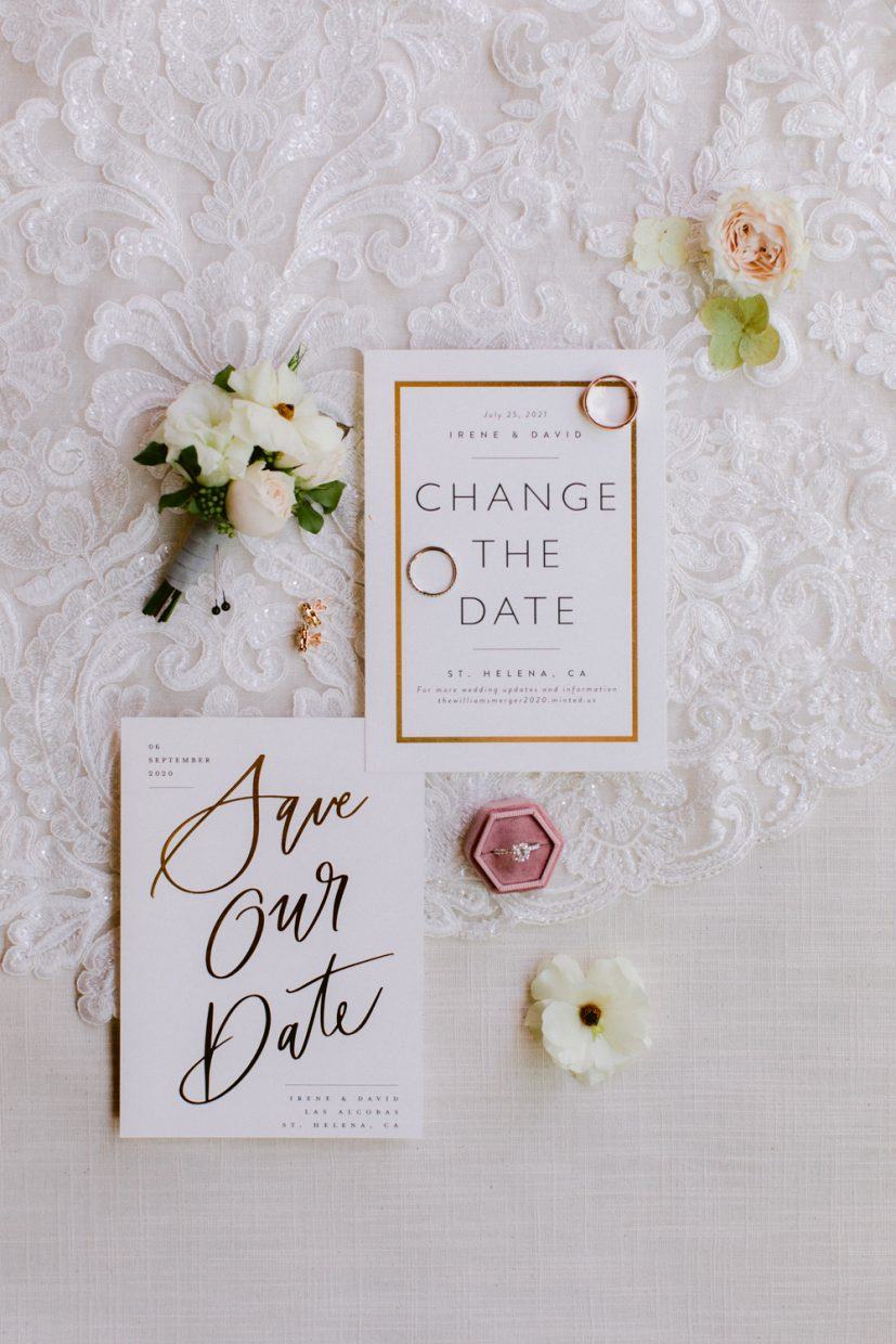 invitation flat lay save the dates