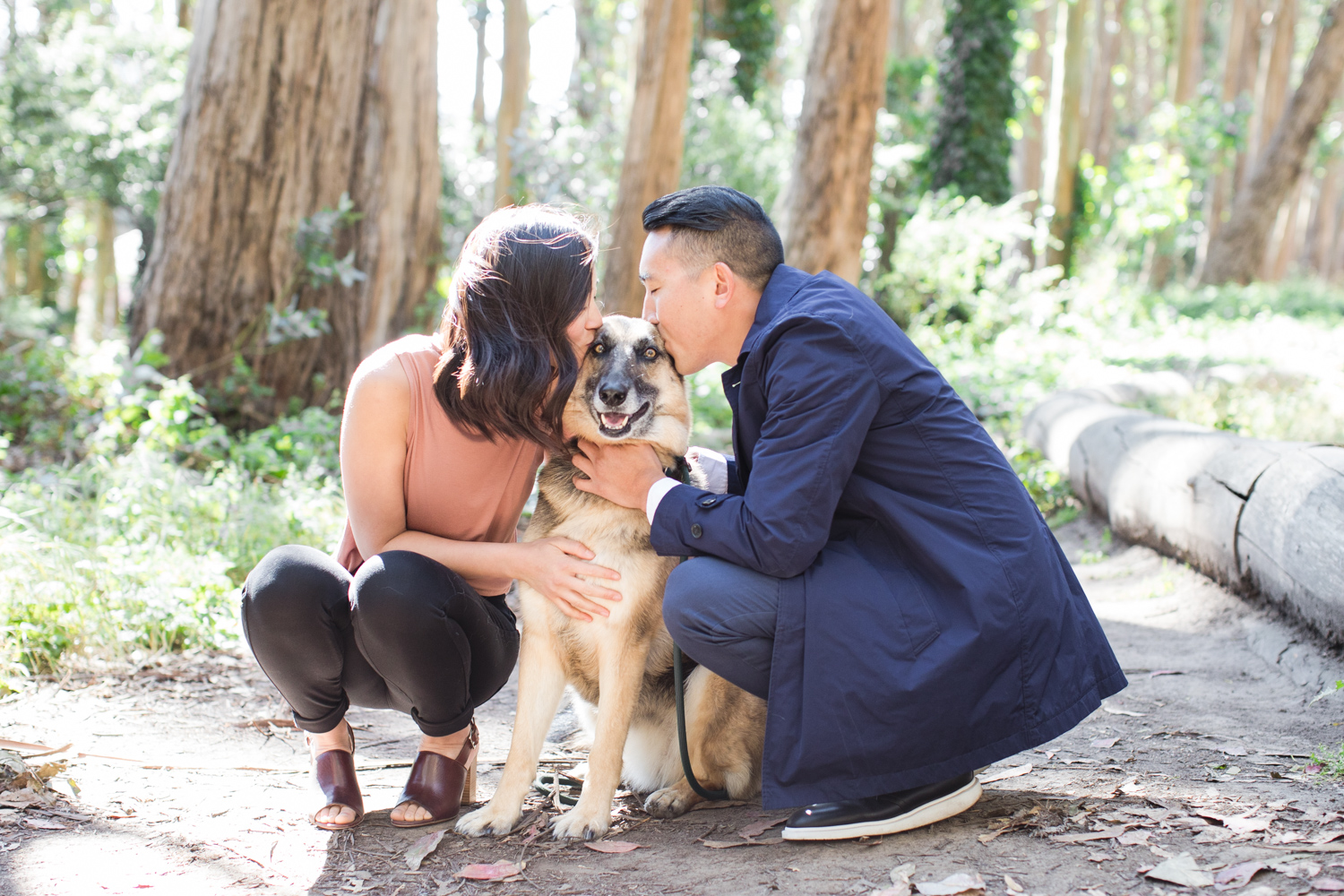 Couple kissing their dog at Lovers Lane engagment