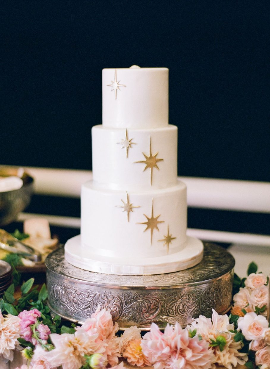 white wedding cake with stars on it