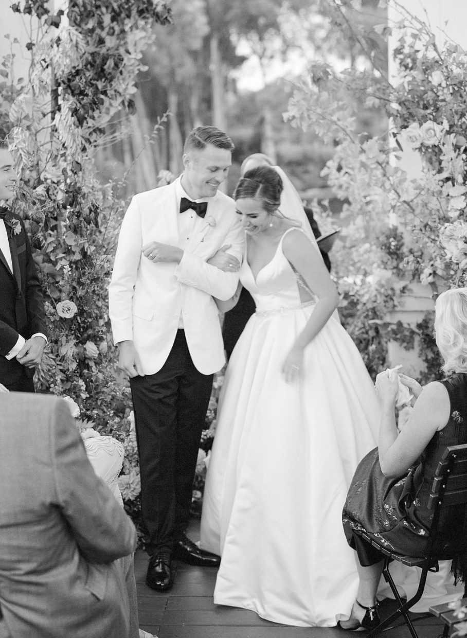 Bride and groom laughing together in an authentic moment