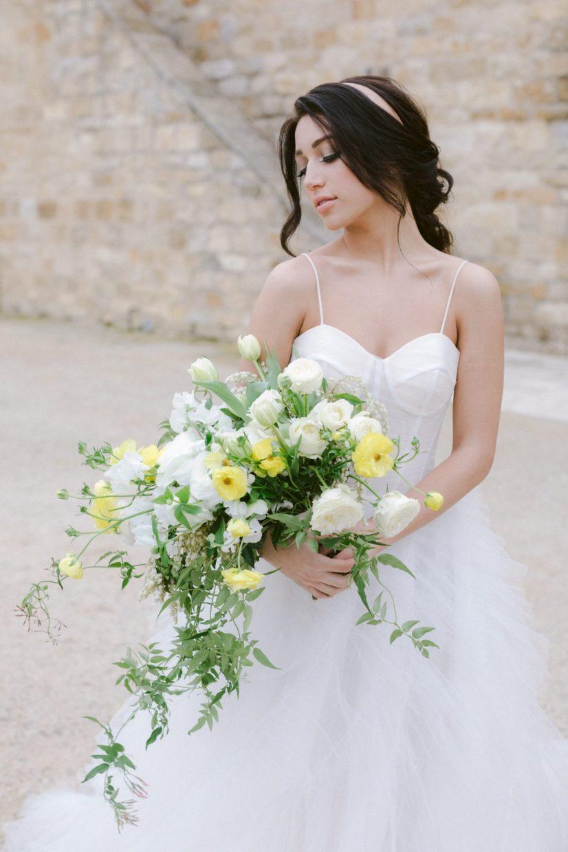 Holding a wedding bouquet